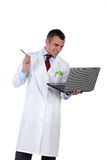 Young doctor and lap top Stock Images