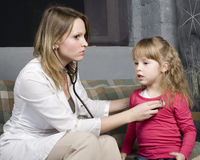 Young doctor with little girl patient feeling bad medical inspection with stethoscope Stock Photo
