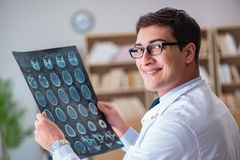 The young doctor looking at computed tomography x-ray image Stock Photo