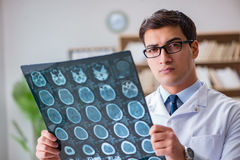 The young doctor looking at computed tomography x-ray image Royalty Free Stock Images