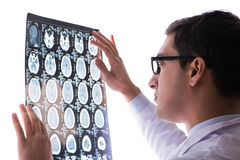 The young doctor looking at computer tomography x-ray image Stock Images