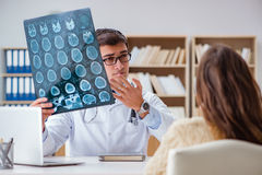 The young doctor looking at computer tomography x-ray image Stock Photos