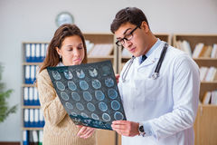 The young doctor looking at computer tomography x-ray image Royalty Free Stock Images