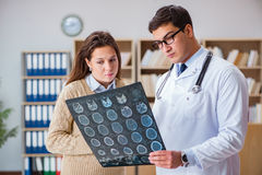 The young doctor looking at computer tomography x-ray image Royalty Free Stock Photos