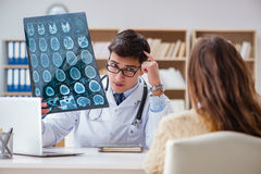 The young doctor looking at computer tomography x-ray image Stock Photo