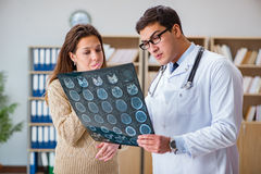 The young doctor looking at computer tomography x-ray image Stock Image