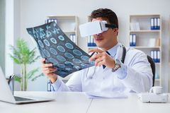 The young doctor looking at mri scan through vr glasses Stock Image