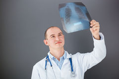 Young doctor looking at xray. Royalty Free Stock Images