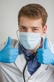 Young doctor making an thumbs up sign Stock Image