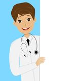 Young doctor man on blue background Royalty Free Stock Photo