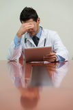 Young Doctor Man With Problems In The Office Royalty Free Stock Photography