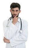 Young doctor man with stethoscope looking serious.  Stock Photo