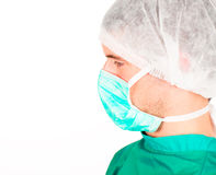 Young doctor with mask and cap Stock Photo