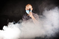 Young doctor in a mask in smoke. Young doctor in a mask in the smoke Royalty Free Stock Image