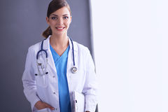 Young doctor or medic with clipboard and Royalty Free Stock Image