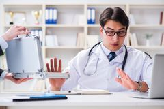 The young doctor in medical insurance fraud concept. Young doctor in medical insurance fraud concept Stock Image