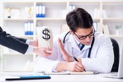 The young doctor in medical insurance fraud concept. Young doctor in medical insurance fraud concept Royalty Free Stock Photos