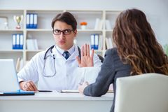 The young doctor in medical insurance fraud concept. Young doctor in medical insurance fraud concept Royalty Free Stock Images