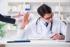 The young doctor in medical insurance fraud concept. Young doctor in medical insurance fraud concept Stock Photos