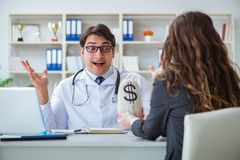 The young doctor in medical insurance fraud concept Stock Images