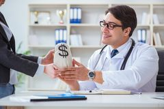The young doctor in medical insurance fraud concept Royalty Free Stock Photos