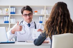 The young doctor in medical insurance fraud concept Royalty Free Stock Images