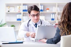 The young doctor in medical insurance fraud concept Royalty Free Stock Image