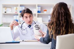 The young doctor in medical insurance fraud concept. Young doctor in medical insurance fraud concept Royalty Free Stock Photography