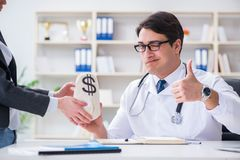 The young doctor in medical insurance fraud concept Stock Photo