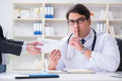The young doctor in medical insurance fraud concept Royalty Free Stock Photo