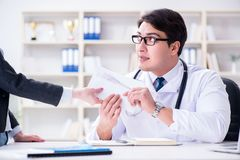 The young doctor in medical insurance fraud concept Royalty Free Stock Photography