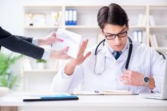 The young doctor in medical insurance fraud concept. Young doctor in medical insurance fraud concept Stock Images