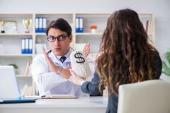 The young doctor in medical insurance fraud concept. Young doctor in medical insurance fraud concept Royalty Free Stock Image