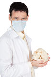 Young doctor in medical mask with a skull Royalty Free Stock Photos