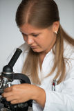 Young doctor with microscope Stock Images