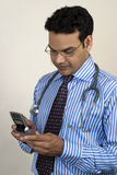 Young doctor with mobile Royalty Free Stock Photo