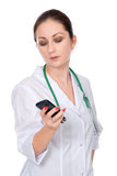 A young doctor with a mobile phone. Stock Photo