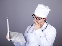 Young doctor with notebook Royalty Free Stock Images