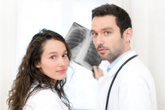 Young doctor and nurse analysing radiography Stock Photography