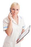 Young doctor or nurse with phone. Young blonde doctor with mobile phone on isolated white background stock images