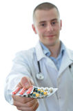 Young doctor offering many drugs isolated Royalty Free Stock Photography