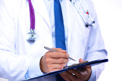 A young doctor in the Office makes an entry Royalty Free Stock Images