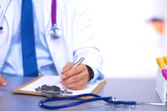 Young doctor in the Office makes an entry. A young doctor in the Office makes an entry Royalty Free Stock Images