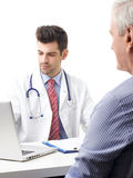 Young doctor and old patient Stock Photos