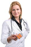 Young doctor passing pills Stock Photo