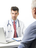 Young doctor with patient Royalty Free Stock Images