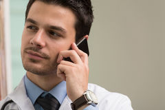 Young Doctor On The Phone Stock Image