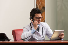 Young Doctor On The Phone Royalty Free Stock Image