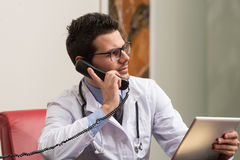 Young Doctor On The Phone Stock Photos