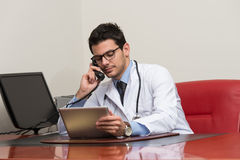 Young Doctor On The Phone Stock Photo